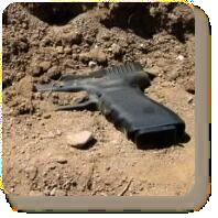 Gun in the dirt